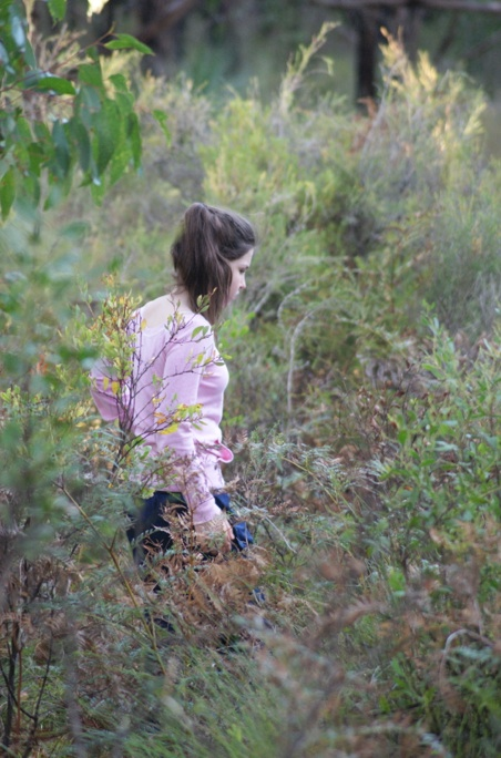 Photo of a girl walking through the Australian bush